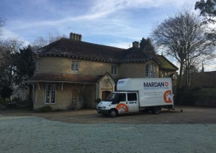 Removal in front of of a big Bath country house.