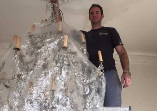 Carefully taking a chandelier down and into storage in Bath
