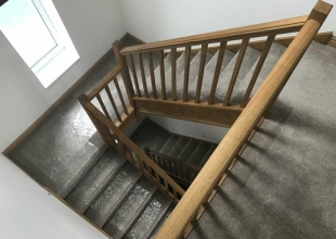 Stairs lined for a removal to protect the carpet